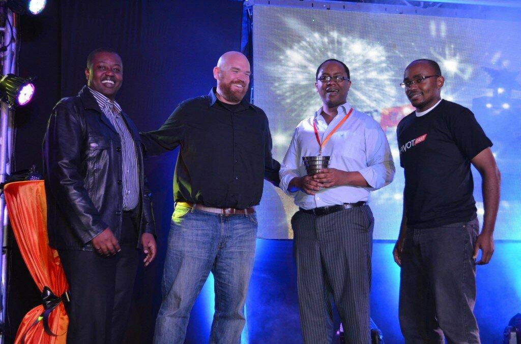 Erik Hersman and Ken Mwenda awarding Go Finance from Tanzania the overall winner of PIVOT East 2013